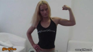 Lulu – Nautural Girl Flexing Biceps And Armwrestling