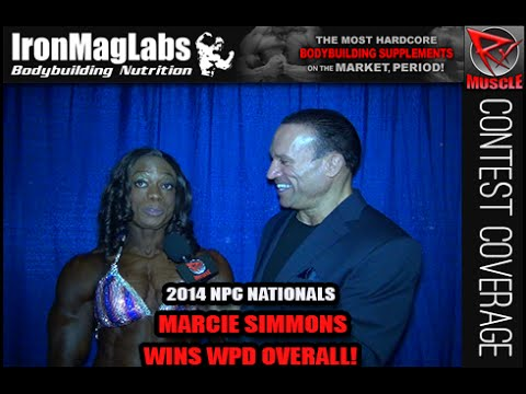 Marcie Simmons After Winning Women's Physique Overall At The 2014 NPC Nationals