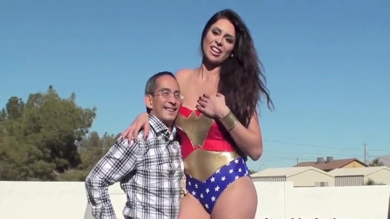 Tall Amazon Compares Tith Tiny Guy